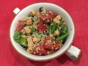 Chickpea and Quinoa salad with red background