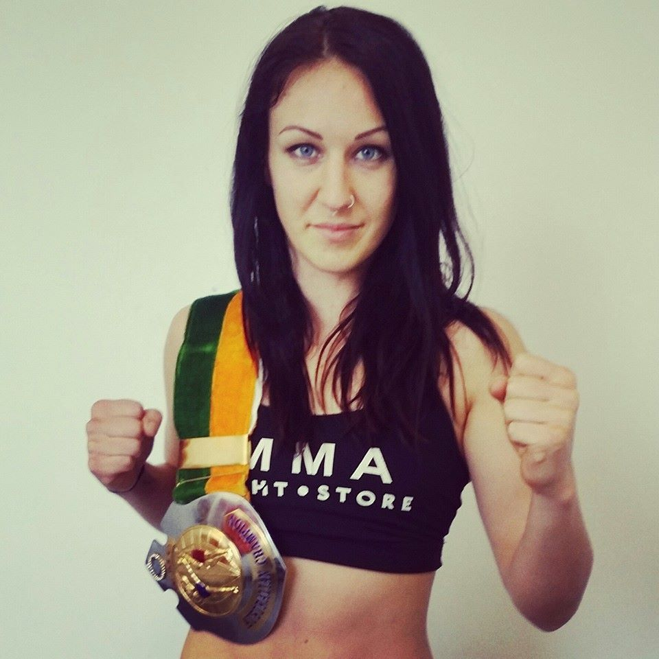 Woman with boxing medal