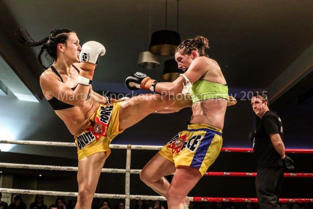 Woman in kickboxing competition in ring