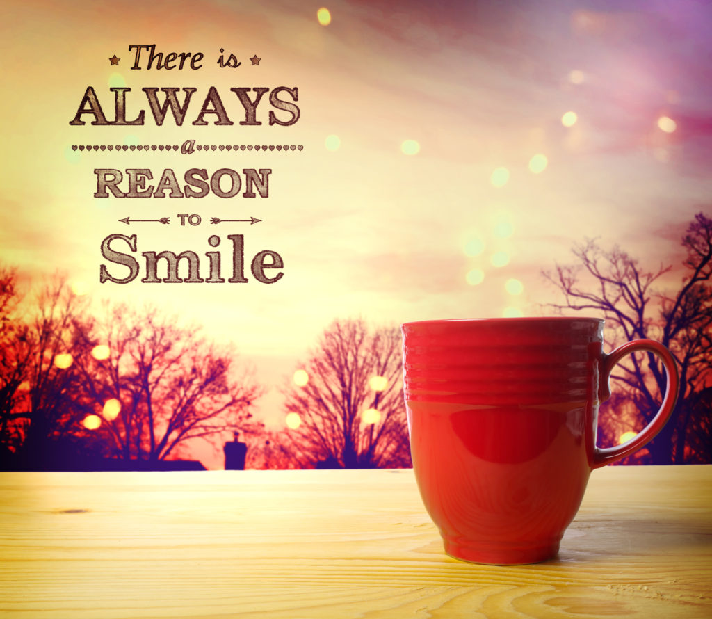 There is Always a Reason to Smile message with red coffee cup