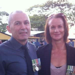 husband and wife with medals