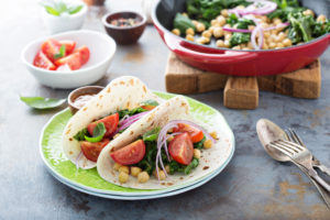 Vegan breakfast tacos with kale, cherry tomato and chickpeas - delicious healthy dish